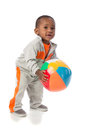 1 year old baby boy standing holding a beach ball Royalty Free Stock Photo