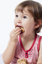 Year old baby eating with gluttony growing up appetite for sweets Stock Photos