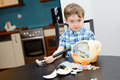 Year old boy and smashed his piggybank at home Stock Images