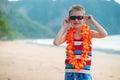 7 year old boy in traditional Hawaiian Lei
