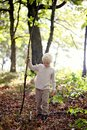 Little Boy with Big Stick Walking in the Woods Royalty Free Stock Photo