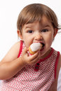 Year old toddler with appetite for sweets female baby eating vanilla eclair cake gluttony Stock Photography