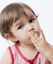 Year old toddler eating cakes and candies with delight sweet guilt for young baby Stock Photography