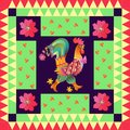 Year of the rooster. Beautiful quilt with cute rooster and bright flowers. Royalty Free Stock Photo
