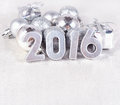 Year silver figures and silvery сhristmas decorations on the background of christmas Royalty Free Stock Photos