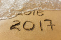 2016 and 2017 year written on beach sea. Royalty Free Stock Photo