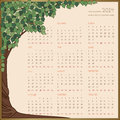 Yearly calendar in green tree frame full year names of months and dates are drawn manually Royalty Free Stock Photo