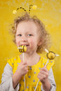 Years old girl is tasting a bee cake pop Stock Photography