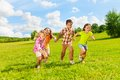Years old kids running together group of little and boys and girls holding hands in the park Royalty Free Stock Photos
