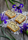 Yeast roll with cocoa and iris flowers on the old wooden board Royalty Free Stock Photography