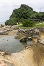 Yehliu geologic park in summer is a cape on the north coast of taiwan in the town of wanli the cape known by geologists as Stock Photo