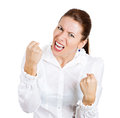 Yelling fists up closeup portrait angry young mad woman student worker accusing screaming in air isolated white background Royalty Free Stock Image