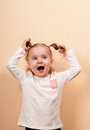 Yelling girl extremely emotional portrait of a little vertical studio shot Royalty Free Stock Photo