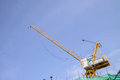 Yello crane boom against a blue sky Royalty Free Stock Photo
