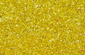 Yellow abstract background. Gold glitter closeup photo. Golden shimmer wrapping paper. Royalty Free Stock Photo