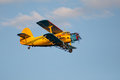 Yellow airplane with double wings flying high Stock Photos