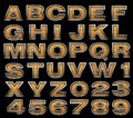 Yellow alphabet with metal Stock Images