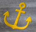 Yellow anchor carved in wood Royalty Free Stock Photo