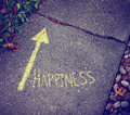 A yellow arrow showing the way to happiness
