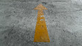 Yellow Arrow Sign On The Ground Royalty Free Stock Photo