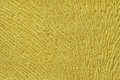 Yellow background from soft textile material. Fabric with natural texture. Royalty Free Stock Photo