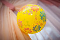 Yellow ball with patterns weighs