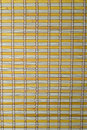 A  yellow bamboo mat texture. Stock Photos