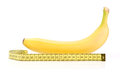 Yellow banana with measuring tape isolated on white background Royalty Free Stock Photos