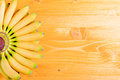 Yellow bananas baby up tips left yellow fan on the board to the right place for your text Royalty Free Stock Photo