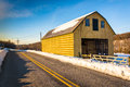 Yellow Barn And A Snow Covered...