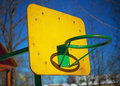 Yellow basketball backboard with ring green without grid in courtyard apartment building Stock Photos
