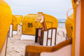 Yellow beach chairs standing on the Royalty Free Stock Images