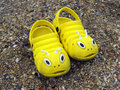 Yellow beach slippers in the form of caterpillars Royalty Free Stock Photo
