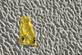 Yellow beach towel on white sand. Royalty Free Stock Photo