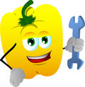 Yellow bell pepper handyman holding a wrench