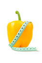 Yellow bell pepper with measuring tape isolated vegetable diet on white Stock Photos