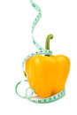 Yellow bell pepper with measuring tape