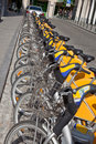 Yellow bicycles on the municipal parking in city brussels Royalty Free Stock Image