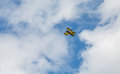 Yellow Biplane Advertising Rides Royalty Free Stock Photo