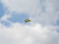 Yellow Biplane in flight Royalty Free Stock Photo