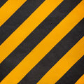 Yellow and black diagonal stripe warning Royalty Free Stock Photo