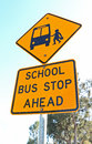Yellow and black school bus stop ahead sign and blue sky Royalty Free Stock Photo