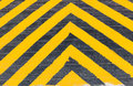 Yellow and Black Stripe warning sign on the danger area Royalty Free Stock Photo