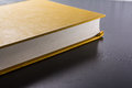 Yellow Blank Hard Cover Paper Front Book Pages Black Desk Royalty Free Stock Photo