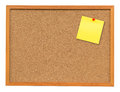 Yellow blank note on Cork board on isolated white with clipping Royalty Free Stock Photo