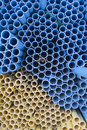 Yellow and blue pvc pipes for construction industry Royalty Free Stock Photos