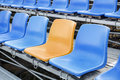 Yellow and blue stadium chair or blue chair Royalty Free Stock Photo