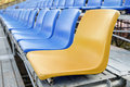 Yellow and blue stadium chair or blue chair Stock Photo