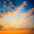 Yellow blue sunrise sky with sunlight bright orange and colors sunset Royalty Free Stock Image