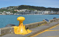 Yellow Bollard on Wellington Harbour Waterfront New Zealand Royalty Free Stock Photo